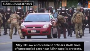 Police in Minneapolis shown on video slashing car tires of protesters