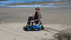 This attachment gives manual wheelchairs motorized off-roading abilities