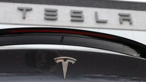 Tesla shares surge to another record high