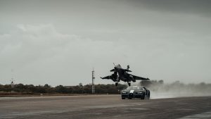 Watch a Bugatti Chiron Sport race a French Navy fighter jet